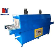 Heat shrinking packing machine of plastic film