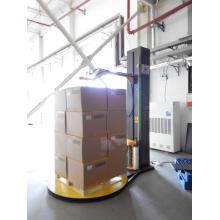 Pre-stretch pallet wrapper with top press