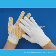 Bleached white cotton knitted working gloves with PVC dots on palm