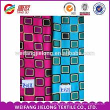 tela impresa rayón tiene patrón de puntos de onda y patrón de piel de serpiente