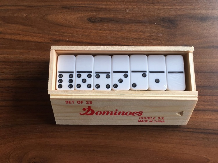 plastic dominos in tin box