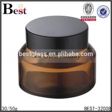 Tarro de cristal ambarino de la boca ancha del color 50g con el casquillo negro, tarro que empaqueta cosmético, tarros del envase poner crema