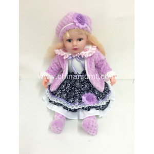 "18"" purple coat vinyl doll"