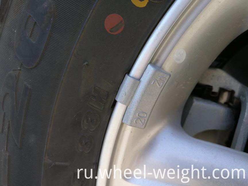 Zn wheel weight alloy on rim