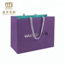 Qualitäts-Großhandelselegantes kundenspezifisches purpurrotes Logo gedruckte Geschenk-Einkaufen-Papiertüte Lieferanten in China