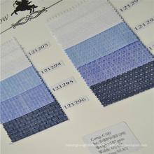 Dobby de algodón con acabado sedoso y tela de stock regular para camisas de gama alta