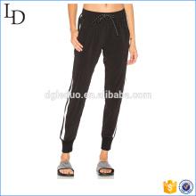 Preto com listras laterais calças de jogging atacado calças de spandex em branco