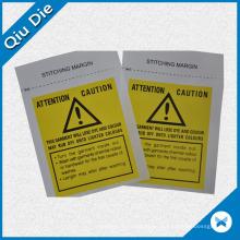Etiqueta de cuidado de lavado de impresión amarilla de precaución para la ropa