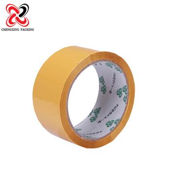 Fita amarelada dos artigos de papelaria da boa selagem