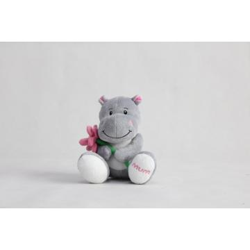 Sitting holding flowers hippo MUM a present