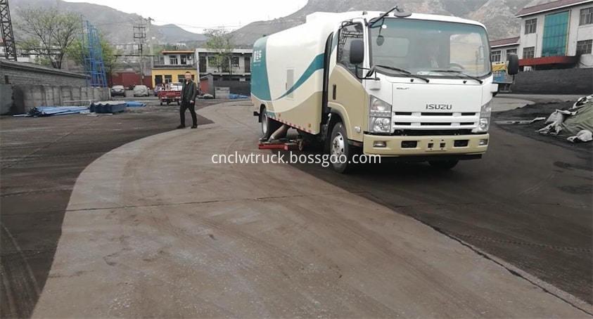 road sweep truck works in coal yard