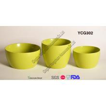 Набор керамических горшков зеленого цвета