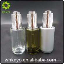 Botella de cristal cosmética transparente del envase del aceite esencial de lujo 30ml con el dropper de la prensa
