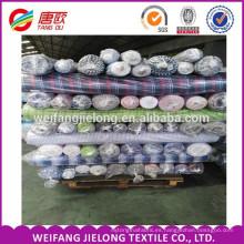 En existencias fabric100% hilados de algodón teñido de cuadros de tela textil para hombres de la camisa de las mujeres vestido de tela a cuadros teñido de telas en Shandong