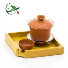 Zisha Red Gongfu Brewing Teaware con Gaiwan Pitcher oliendo y bebiendo tazas