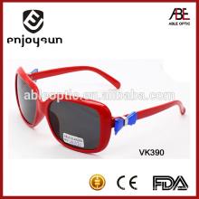La manera embroma las gafas de sol, gafas de sol plásticas del cabrito, gafas de sol de las muchachas.
