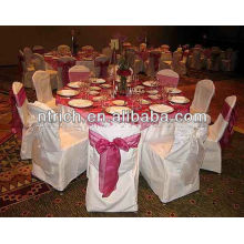 White polyester chair cover with organza sash for wedding
