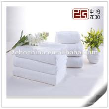Pure Blanco Venta al por mayor tejidos de tela plana 32s algodón toalla de hotel establece