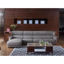 Серый кожаный диван с шезлонгом