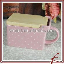 glazed pink ceramic reserve bin