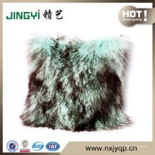 Coussin de fourrure d'agneau mongol en gros tibétain gris avec dessus de neige