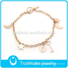 TKB-JB0015 Fashionable pure rose gold 316L stainless steel bracelets & bangles with casting hollow keys,moon,handbag and stars