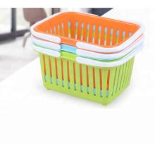 Cesta de almacenamiento de plástico portátil barato con mango