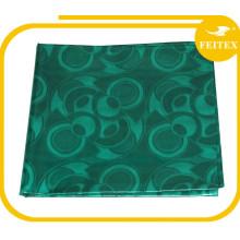 China venta al por mayor de prendas de vestir verdes Shadda Guinea brocado algodón tela de cuero venta al por mayor Bazin Riche vestidos de mujer FEITEX