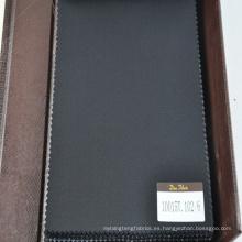 tela adaptable de lana pura azul oscuro en diseño de espiga pequeña
