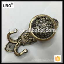 brass curtain tieback for window