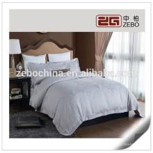 Cinco Estrellas Hotel Jacquard de Lujo Fabric White Hotel Bedding Sets