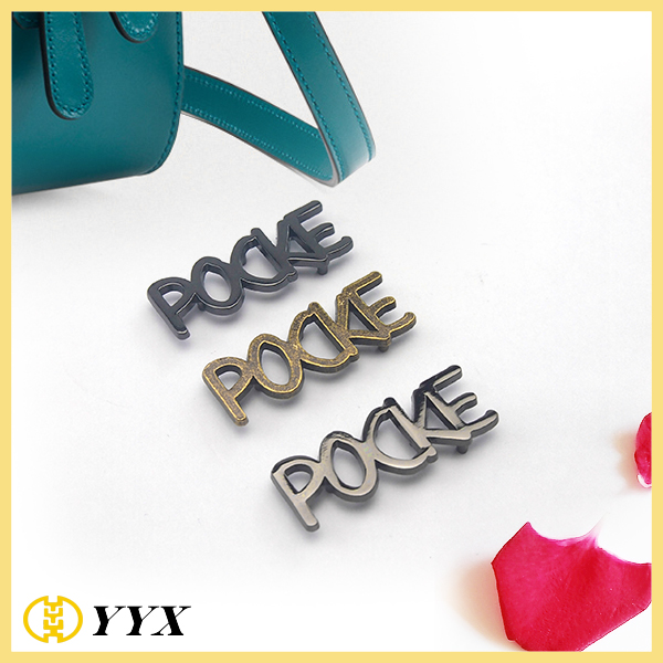Metal letter logo for purse