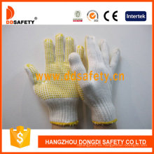 Guantes de algodón hechos punto vendedores calientes con PVC amarillo Dkp114