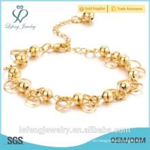 Vogue estilo 18K chapado en oro pequeñas campanas pulsera para las mujeres
