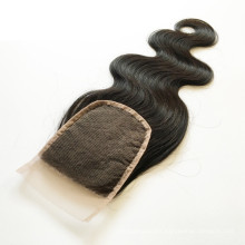 Qingdao Factory Cheap Natural Color Brazilian Hair Silk Base Lace Closure