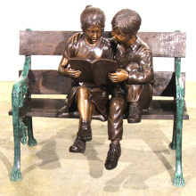 theme park statue metal craft bronze children on bench sculpture