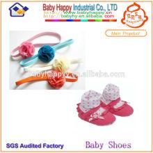 Zapatillas de calzado de bebé de moda y conjunto de hairband