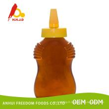 Miel de Polyflower frais dans une bouteille en plastique de 500g Squeeze