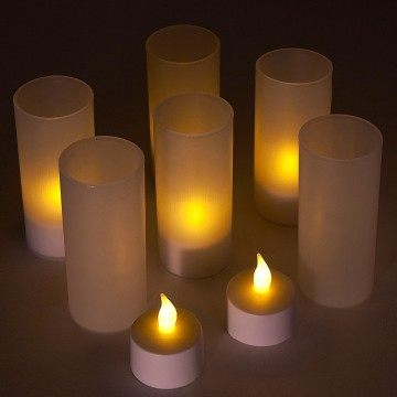 Flickering charging LED tealight candle