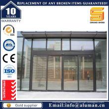 Puerta corredera de bronce de aluminio con vidrio reflectante