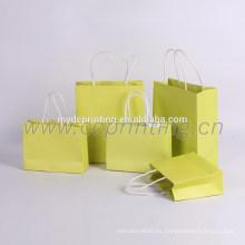 bolsos de compras de papel de mano paquete de papel amarillo para la ropa
