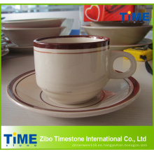 Taza de café expreso y platillo
