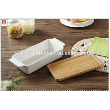 Good quality rectangular white ceramic baking plate with bamboo lid