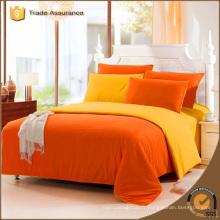 Ensemble de literie imprimé réactif en tissu à couleur orange solide pour pas cher