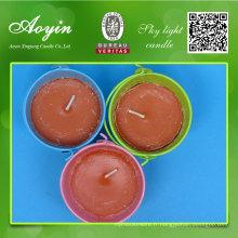 Bougies colorées repoussant les moustiques dans les seaux