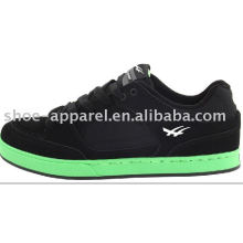 black suede skate shoes with green sole