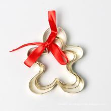 Juego de cortador de galletas de chapado en oro de ginger man de navidad
