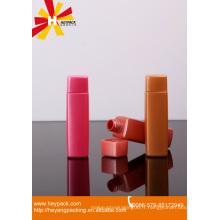 Bouteille d'huile essentielle en plastique rose et marron