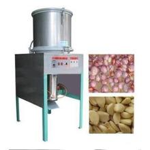 Máquina de descascao com alho quente