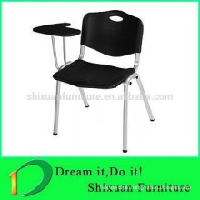 China training chair with folded writing tablet